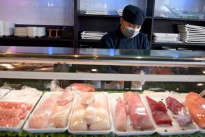 Jacky Pan, sushi chef, works a the new sushi bar at Hunan Noodle Bar in Ridgefield. Owner Jason Januar would like to open a third restaurant but faces staffing issues. July 29, 2021, in Ridgefield, Conn.