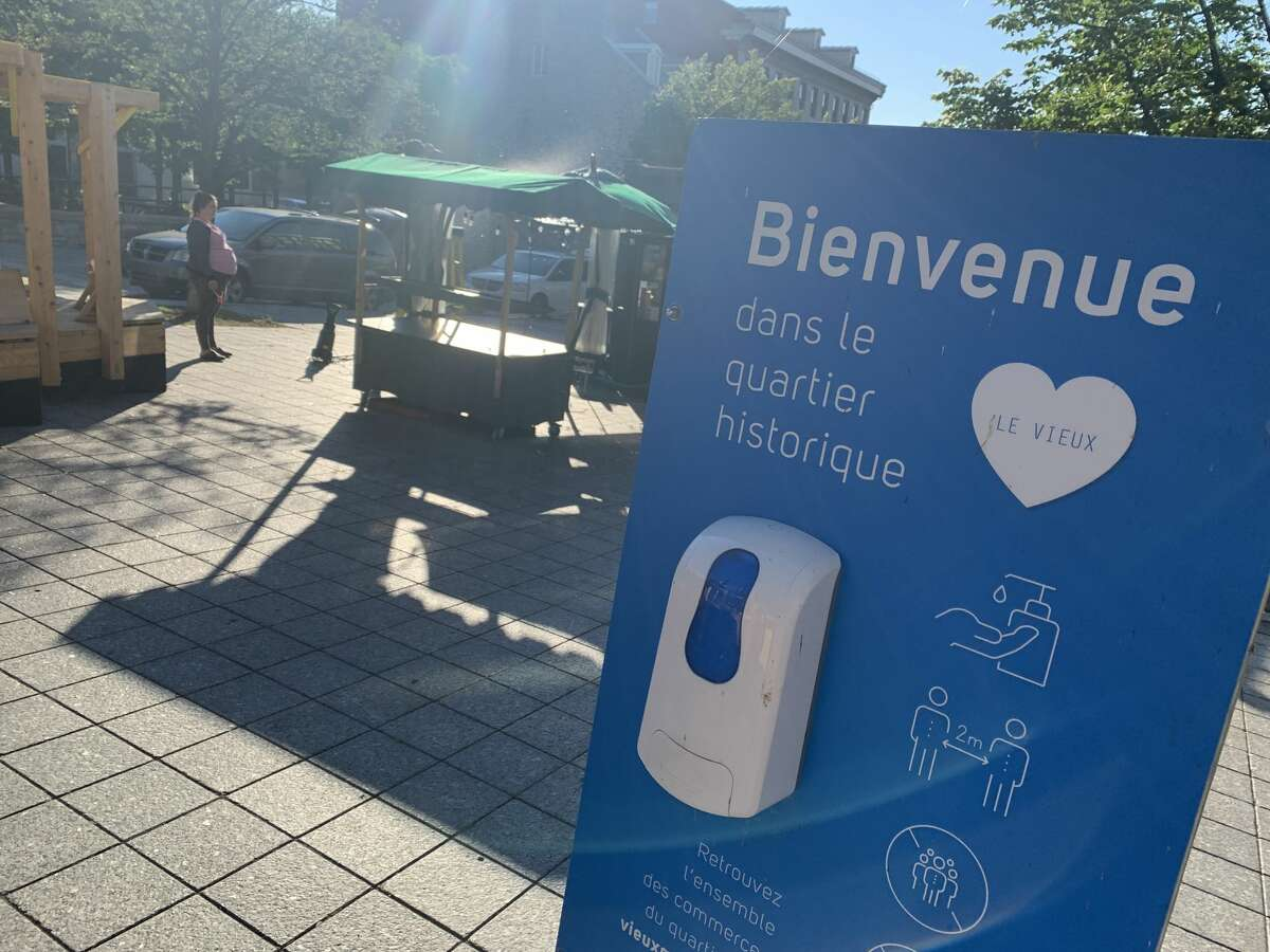 A dispenser with hand sanitizer set up in Old Montreal, a tourist hub, in July 2021. (Rebekah F. Ward/Times Union)