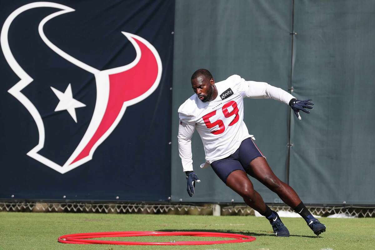 Houston Texans outside linebacker Whitney Mercilus (59) runs a drill during an NFL training camp football practice Friday, July 30, 2021, in Houston.