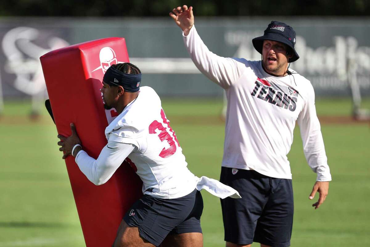 Houston Texans defensive back Jonathan Owens (36) hits a blocking dummy while working on techniques before an NFL training camp football practice Friday, July 30, 2021, in Houston.