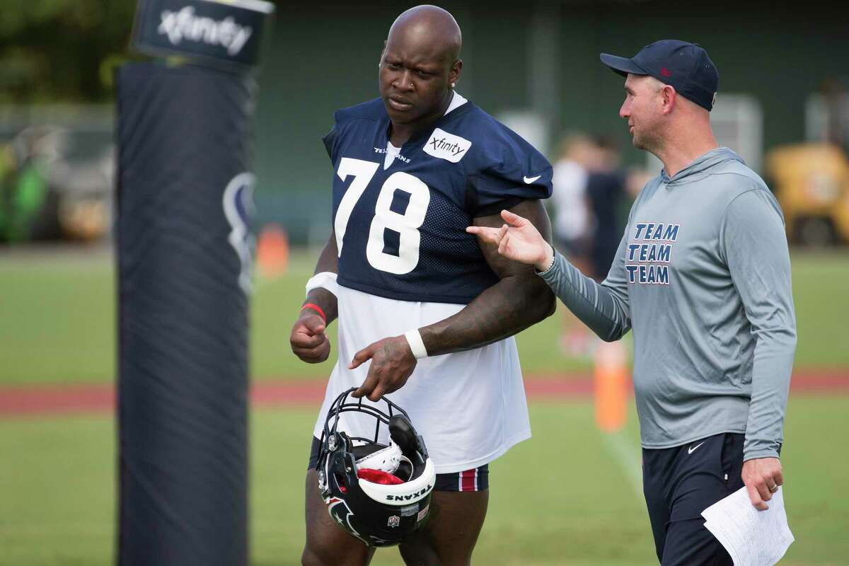 Houston Texans offensive tackle Laremy Tunsil (78) walks off the field with Jack Easterby during an NFL training camp football practice Friday, July 30, 2021, in Houston.