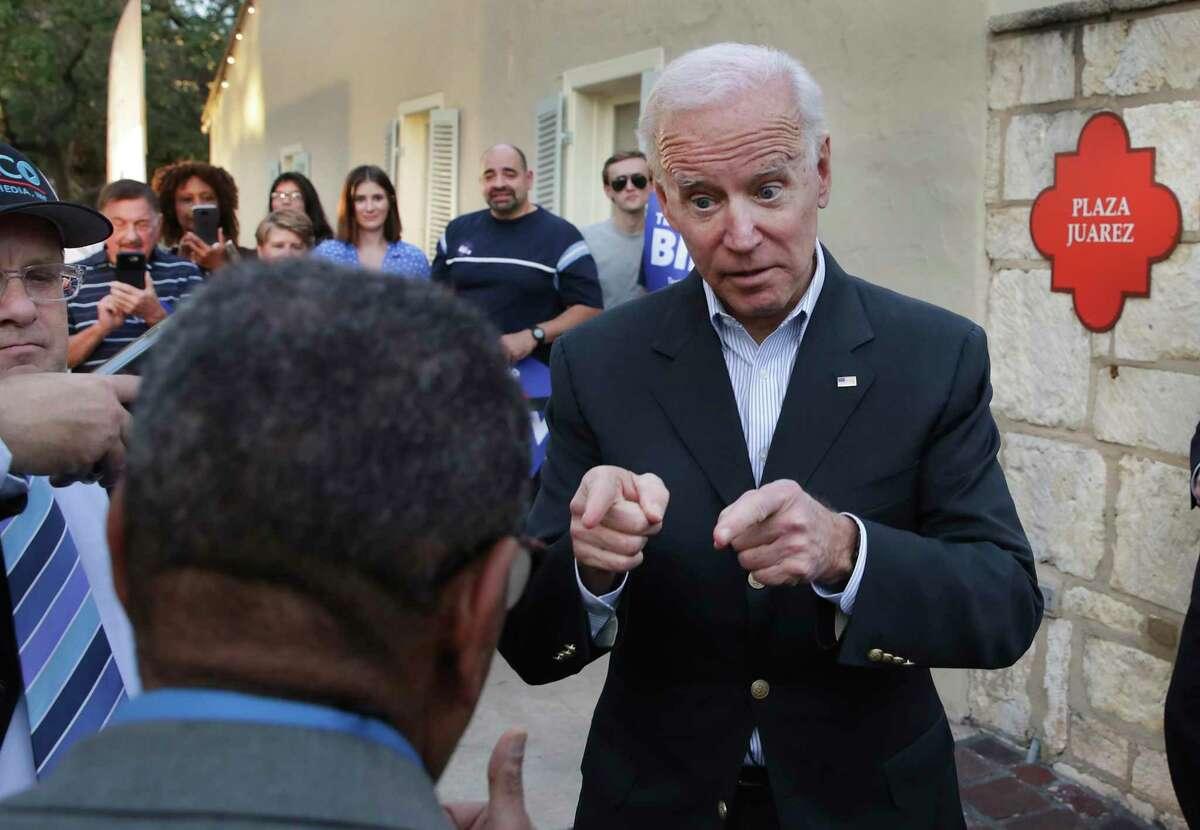Joe Biden talks to a supporter at a campaign rally at La Villita in San Antonio on Dec. 13, 2019.