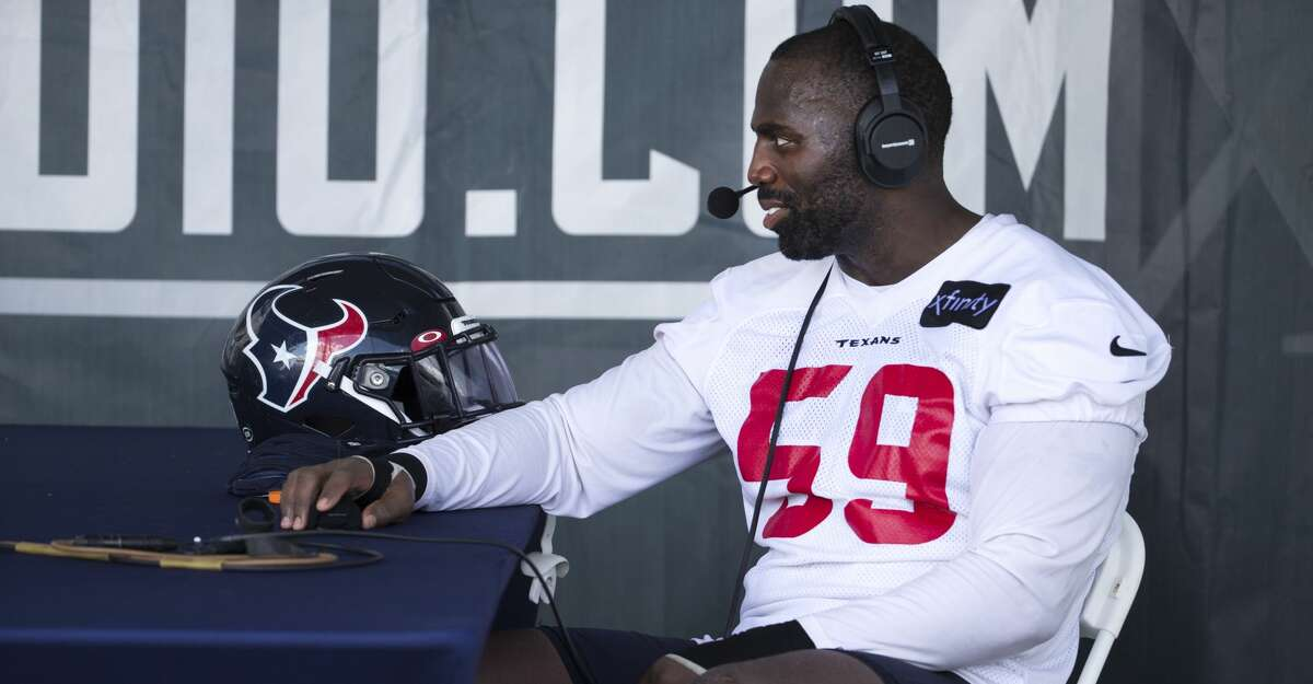 Houston Texans outside linebacker Whitney Mercilus sits in for a radio interview after an NFL training camp football practice Friday, July 30, 2021, in Houston.