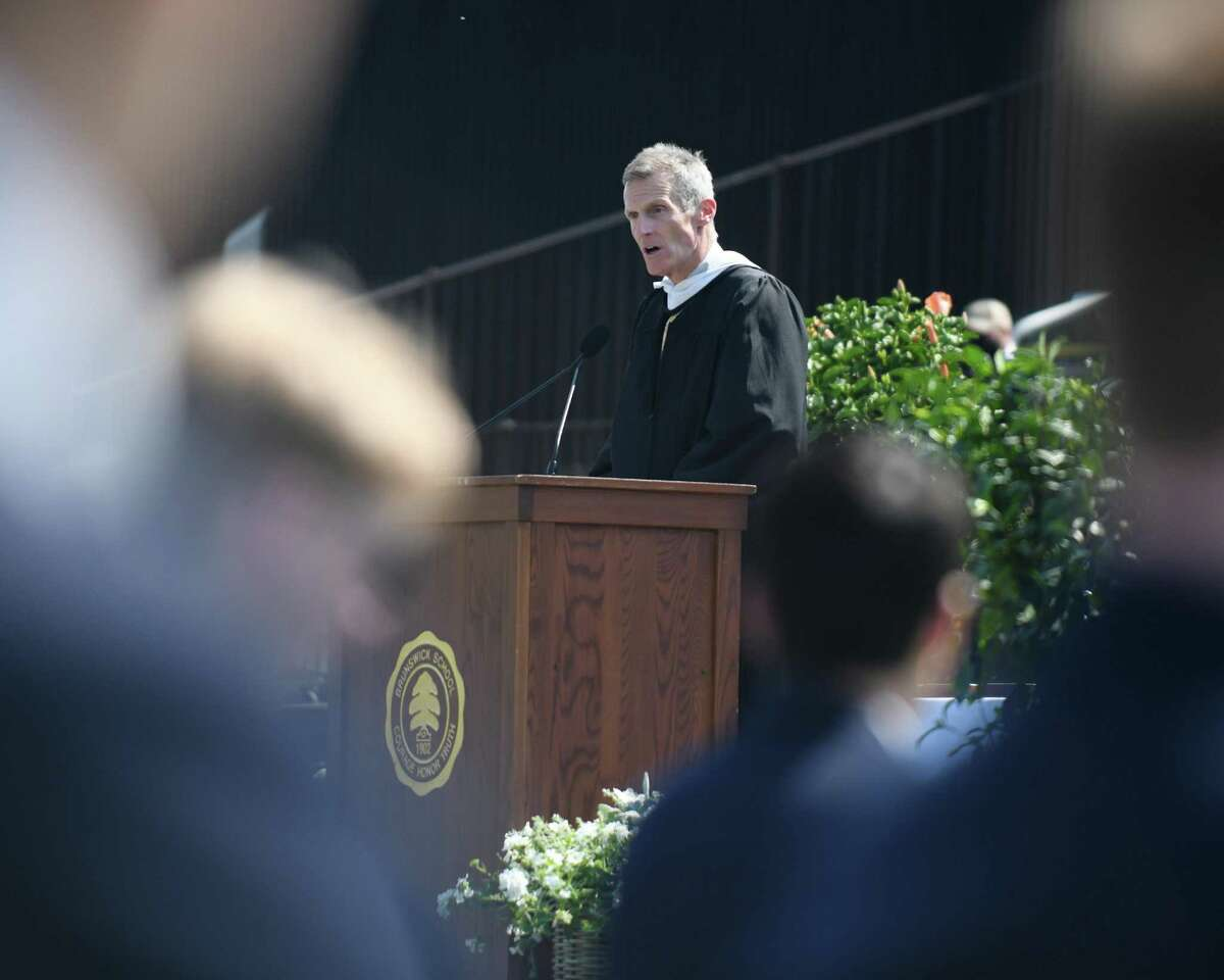 Head of School Thomas Philip speaks during the 2021 commencement ceremony at Brunswick School in Greenwich, Conn. Wednesday, May 19, 2021. 104 students graduated during the outdoor ceremony at Cosby Field, featuring a virtual commencement speech by Connecticut Gov. Ned Lamont.