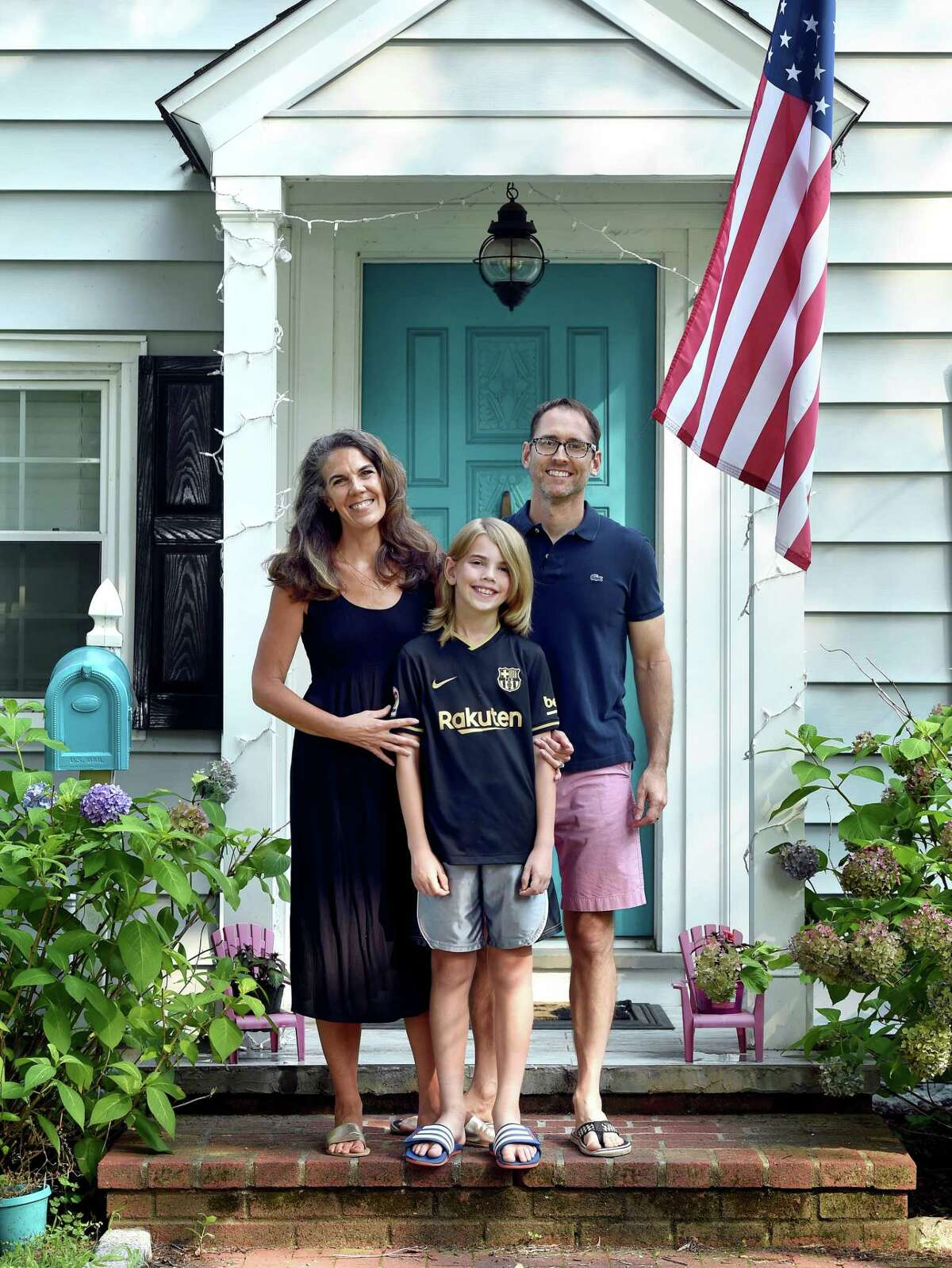 From left, Marney White, her son, Lane Mayville, and husband, Erik Mayville, photographed in front of their home in Fairfield on July 27, 2021.