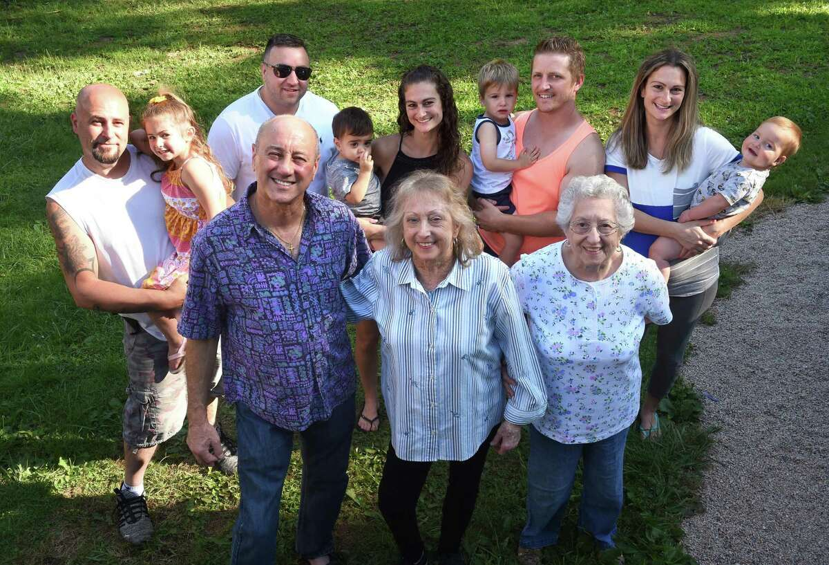 Kidney transplant recipient Sandy Ragozzino, front center, is photographed with her brother and kidney donor, Stan Swidock, front left, her mother, Vincenza Swidock, front right, and her extended family in North Branford on July 30, 2021. From left in the back row are Ragozzino's son-in-law, Bernie Russo, and his daughter, Isabella, 4, son, Nick Ragozzino, daughter Amy Russo, and her son, Anthony, 16 months, son-in-law, Kyle Samuel, and his son, Cameron, 21/2, and daughter, Wendy Samuel, and her son Ashton, 15 months.