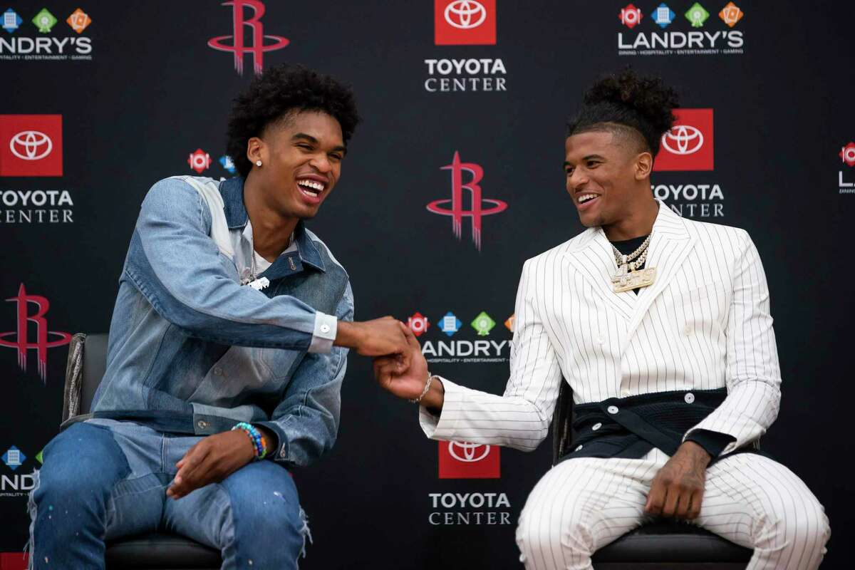 New Houston Rockets Josh Christopher and Jalen Green laugh as they talk about how they think the other one plays the game during an introductory press conference for the players acquired in Thursday's NBA draft, Friday, July 30, 2021, at Toyota Center in Houston.