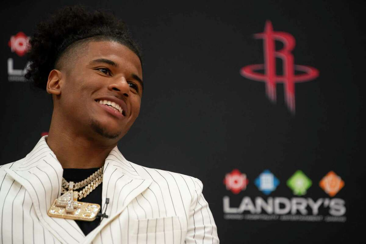 New Rockets guard Jalen Green smiles as he speaks during an introductory press conference for the players acquired in Thursday's NBA draft, Friday, July 30, 2021, at Toyota Center in Houston.