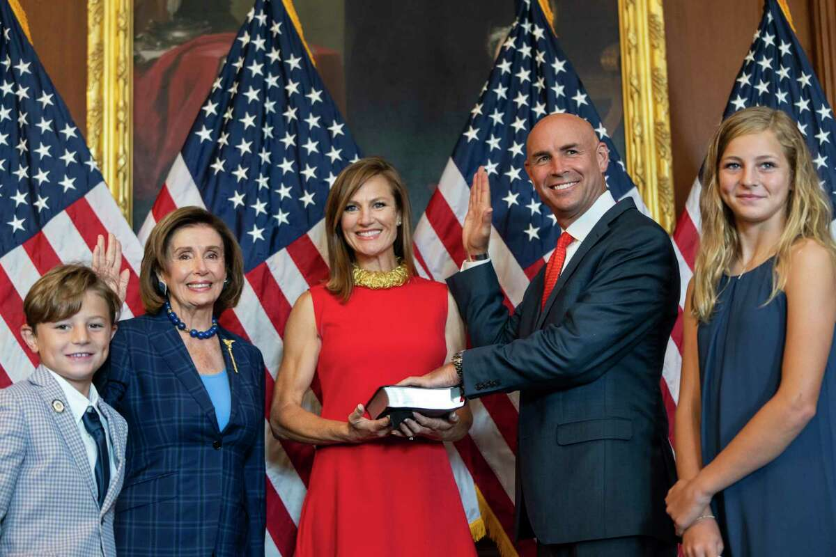 Newly-elected Rep. Jake Ellzey (R-TX) and his family participate in a ceremonial swearing-in with Speaker of the House Nancy Pelosi (D-CA) at the U.S. Capitol on July 30, 2021 in Washington, DC. Ellzey won a special election in Texas's 6th Congressional district and replaces the late Rep. Ron Wright, who died from Covid-19 in February.
