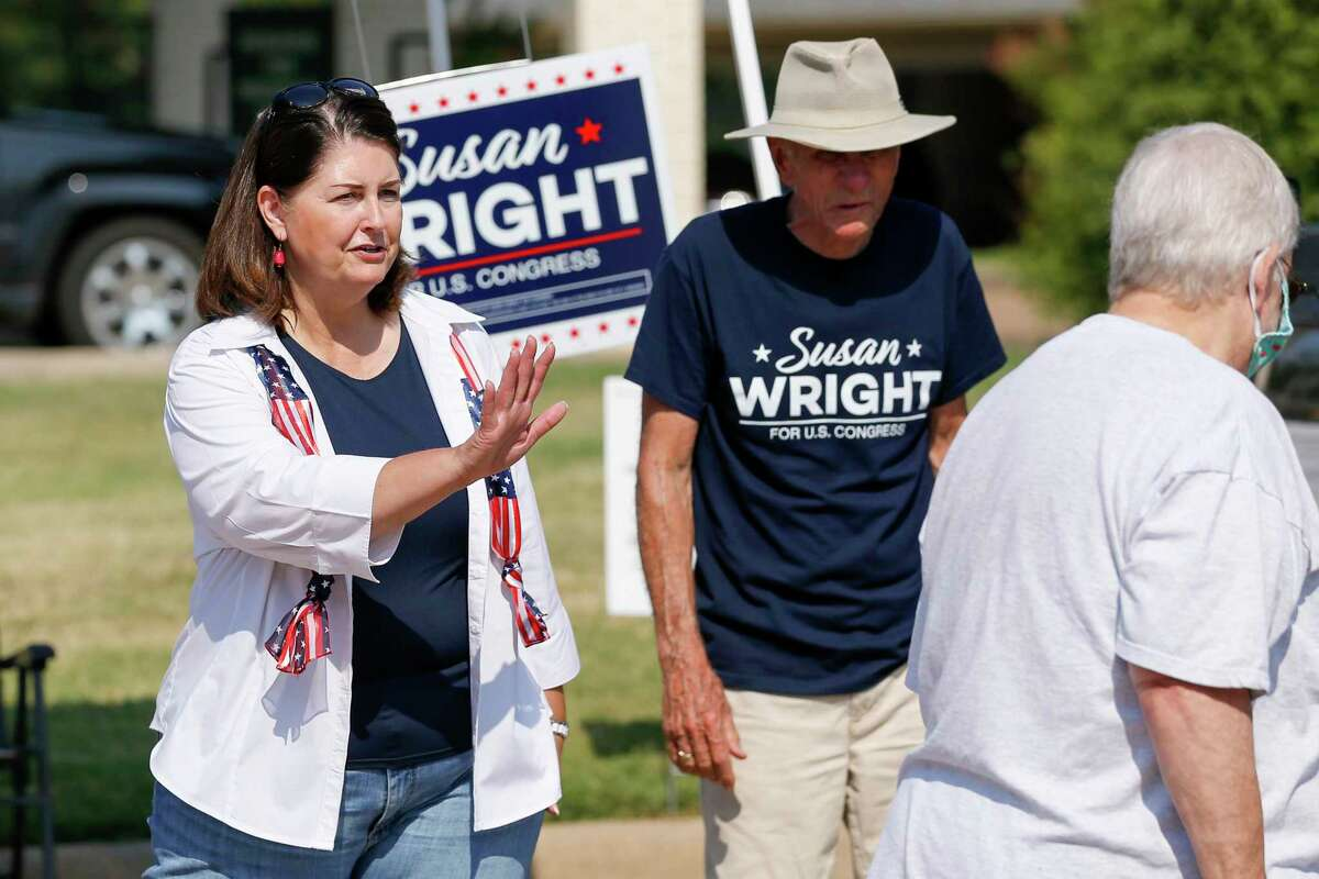Susan Wright, a Republican candidate for Texas' 6th Congressional District, greets voters on July 22, 2021 outside a polling location during early voting for a special runoff election in Arlington, Texas. She later fell short in her bid to capture the seat held her husband, U.S. Rep. Ron Wright, who died in February after contracting COVID-19. Jake Ellzey was declared the victor.