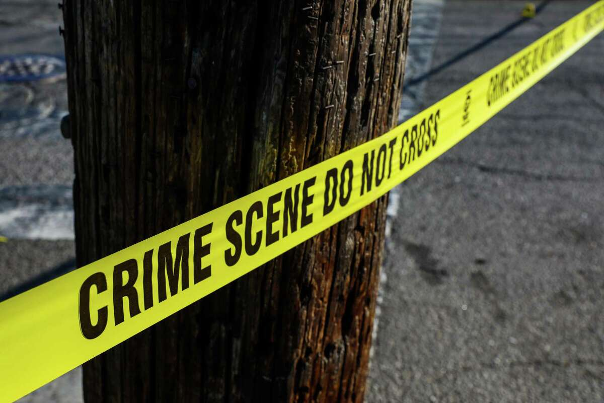 A crime scene at School Street and Pleitner Avenue in Oakland is cordoned off after a shooting on June 25. High-profile cases played up by the media is driving public perception that crime is up, experts say, when overall crime statistics show it is not.