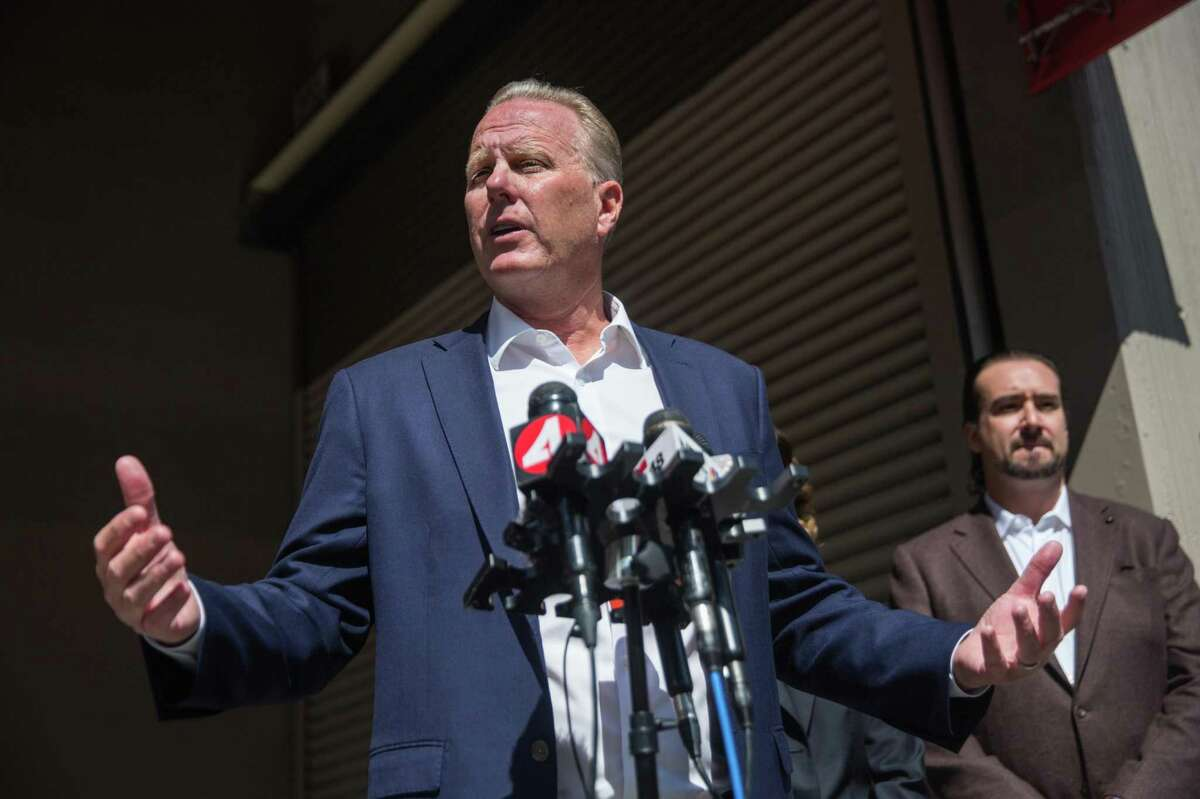 Former San Diego Mayor Kevin Faulconer, a Republican running in the 2021 California gubernatorial recall election, speaks to reporters in front of a shuttered Walgreen's in San Francisco on July 27.