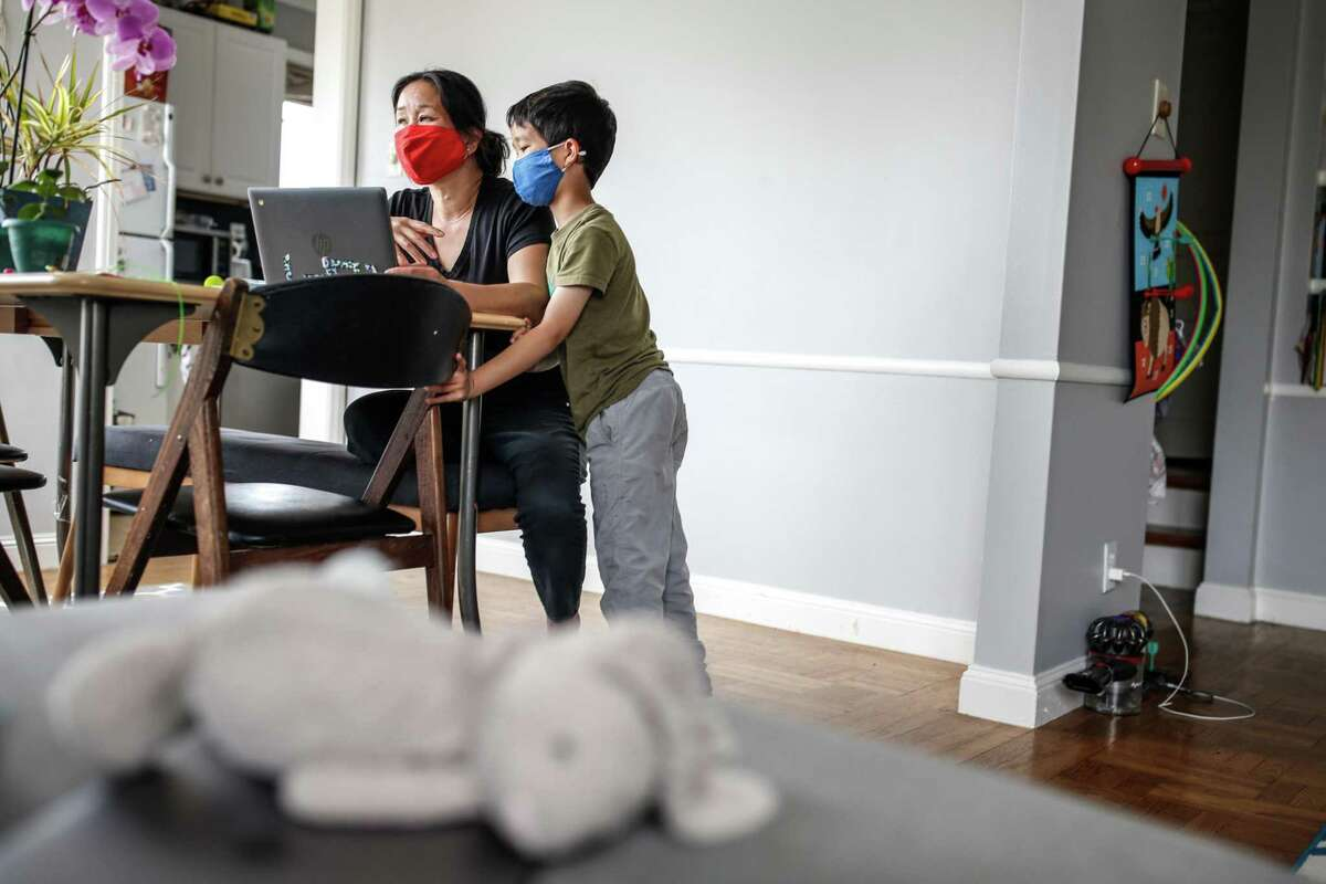 Kimberly Shu sets up a reading activity for her son Lucas.