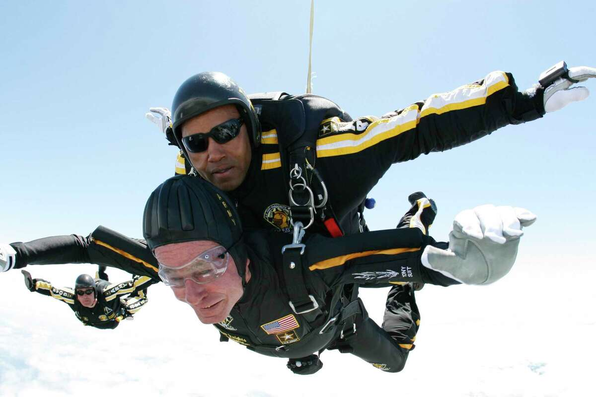 Retirement: In this photo provided by Army Golden Knights, former President George H. W. Bush, bottom, rides tandem with Sgt. Michael Elliott of the Army Golden Knights parachute team as he celebrates his 85th birthday with a parachute jump, Friday, June 12, 2009, in Kennebunkport, Maine.