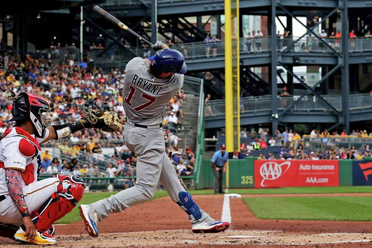 Chicago Cubs' Kris Bryant follows though on a solo home run off Pittsburgh Pirates starting pitcher Jordan Lyles, center, during the first inning of a baseball game in Pittsburgh, Thursday, July 4, 2019. The Cubs won 11-3.(AP Photo/Gene J. Puskar)