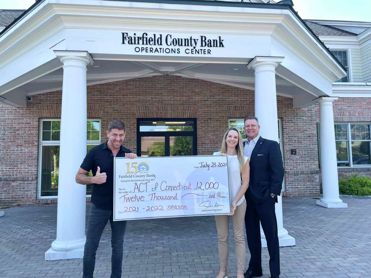 The employees of Fairfield County Bank have donated $12,000 to the employees at ACT, (A Contemporary Theatre). Pictured in the photo from the left to the right are: Daniel Levine, who is the artistic director of the theater, Katie Diamond, who is the executive director of the theater, and Daniel Berta, who is the president of the bank.