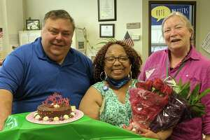 It was a sad but celebratory day as Ruby Durant, middle, officially retired from the town's registrar of voters office. A celebration in her honor was held Thursday, with co-workers dropping in to say goodbye. Durant poses with Republican Registrar of Voters Fred DeCaro III and Democratic Registrar of Voters Mary Hegarty.
