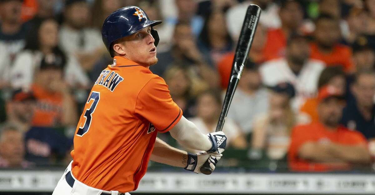 Houston Astros center fielder Myles Straw (3) hits a base hit during the second inning of a game between the Houston Astros and Texas Rangers on Friday, July 23, 2021, at Minute Maid Park in Houston.
