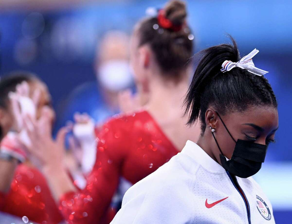 27 July 2021, Japan, Tokio: Gymnastics: Olympics, team, women, final at Ariake Gymnastics Centre: Simone Biles of the USA wears a mask after leaving the team final with an injury. Photo: Marijan Murat/dpa (Photo by )