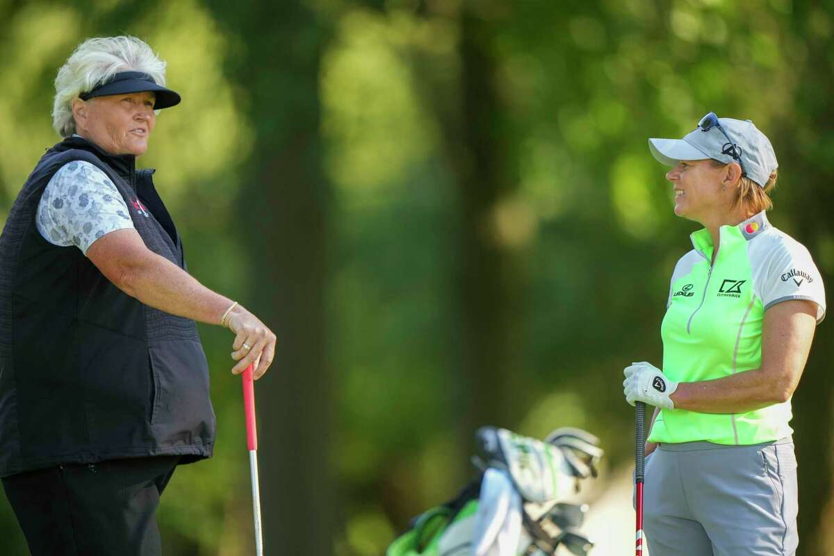 Annika Sorenstam, right, and Laura Davies talk during the second round of the U.S. Senior Women's Open in Fairfield on Friday.