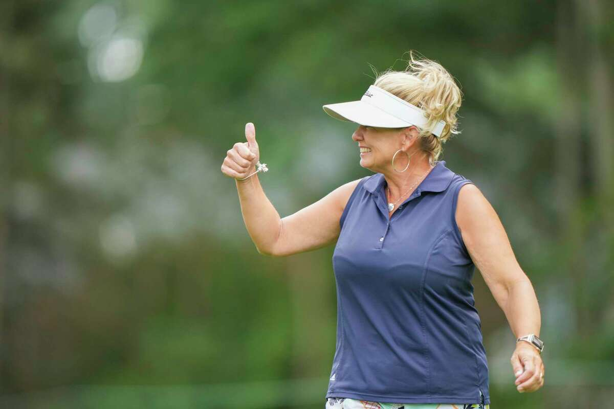 Dana Ebster reacts after a shot during the second round of the U.S. Senior Women's Open in Fairfield on Friday.