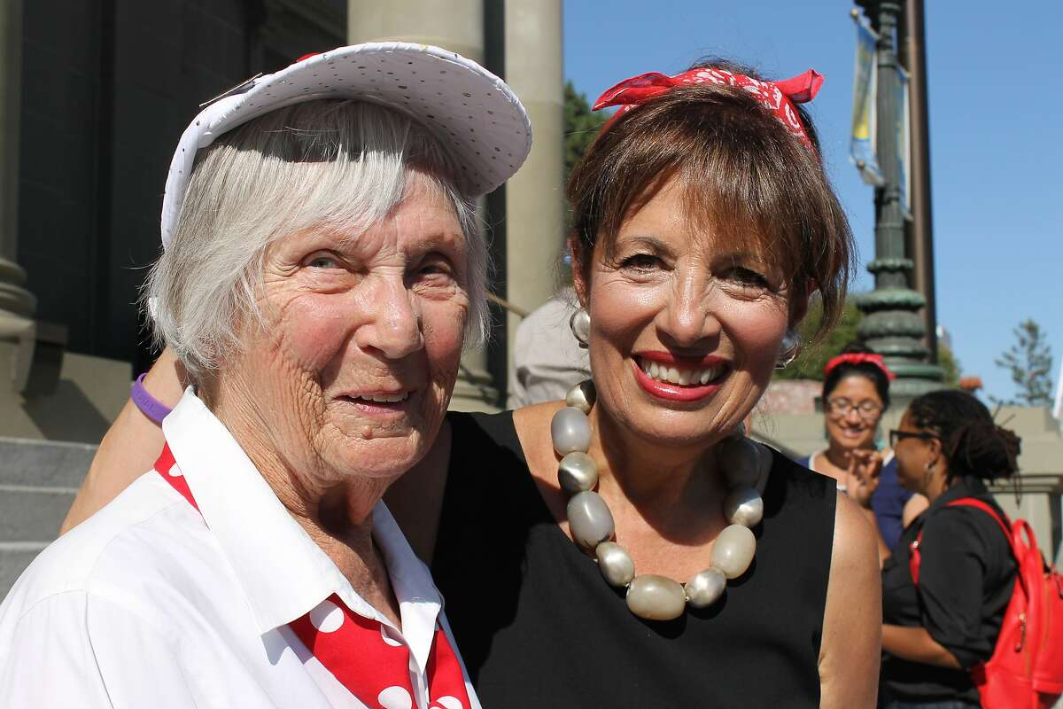 Phyllis Gould, a World War II Rosie the Riveter who died in July 2021, talks with Rep. Jackie Speier in 2014 at an event at the San Mateo County History Museum in Redwood City advocating for women's rights. Speier, wearing a red bandana in homage to the Rosie the Riveters, led the bill in the House that created a Congressional Gold Medal in honor of the Rosies, and Gould pushed hard for that effort.