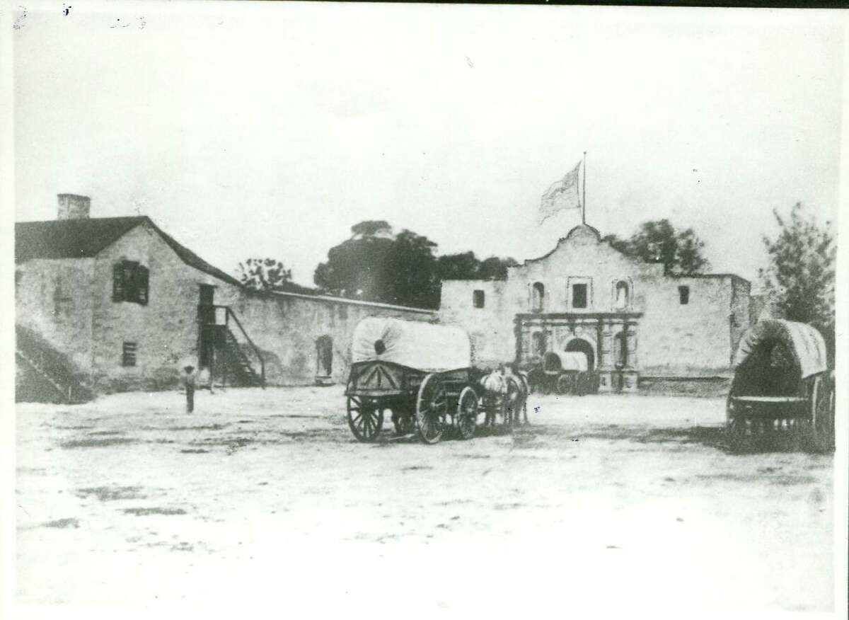 This 1868 photo show the Alamo in its post-battle role as a U.S. Army quartermaster depot. The Army remodeled the Long Barrack and placed a roof on the church that helped protect it from the elements.