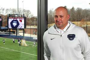 UConn Athletic Director David Benedict, poses at the Joseph J. Morrone Stadium at Rizza Performance Center on the campus in Storrs, Conn., on Thursday Mar. 4, 2021.
