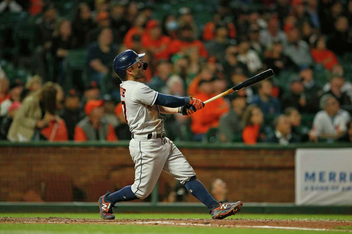 Houston Astros second baseman Jose Altuve (27) homers on a fly ball to left field against the San Francisco Giants in the fifth inning during an MLB game at Oracle Park, Friday, July 30, 2021, in San Francisco, Calif.