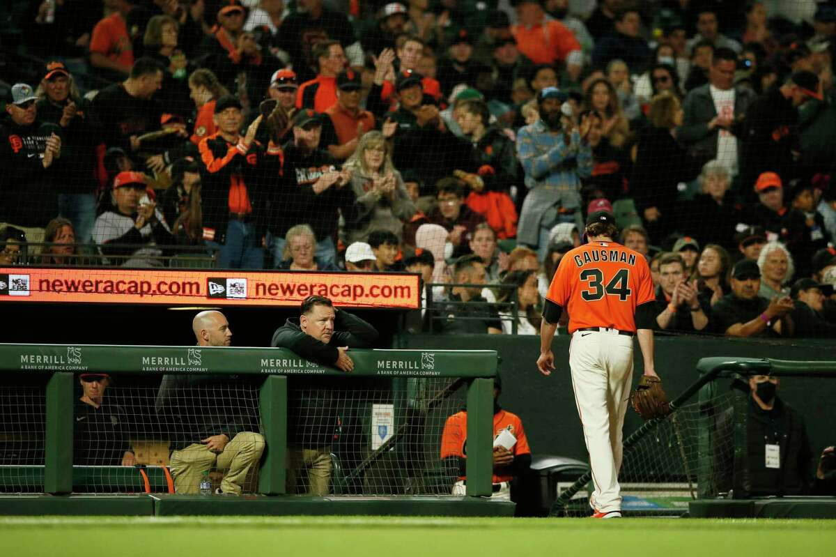 San Francisco Giants starting pitcher Kevin Gausman (34) is taken out in the fifth inning during an MLB game against the Houston Astros at Oracle Park, Friday, July 30, 2021, in San Francisco, Calif.