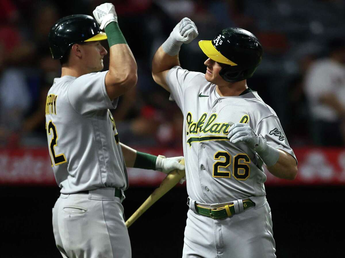 ANAHEIM, CALIFORNIA - JULY 30: Matt Chapman #26 of the Oakland Athletics celebrates a home run with Sean Murphy #12 against the Los Angeles Angels in the eighth inning at Angel Stadium of Anaheim on July 30, 2021 in Anaheim, California. (Photo by Ronald Martinez/Getty Images)