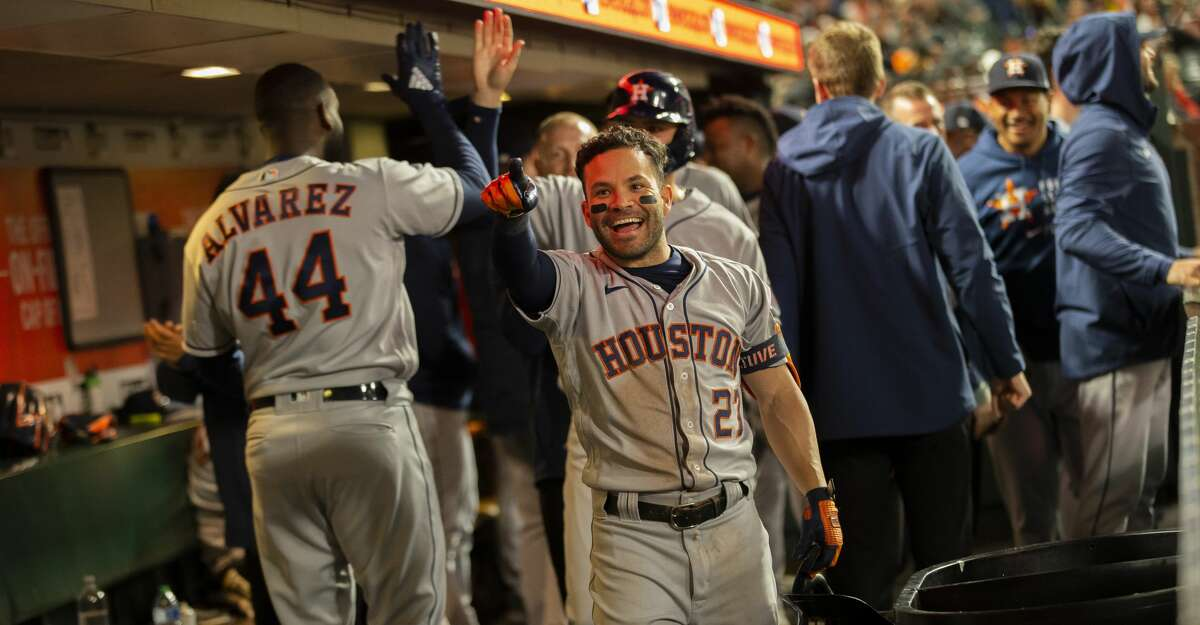 Houston Astros second baseman Jose Altuve (27) celebrates in the dugout after his grand slam home run in the sixth inning during an MLB game at Oracle Park, Friday, July 30, 2021, in San Francisco, Calif.