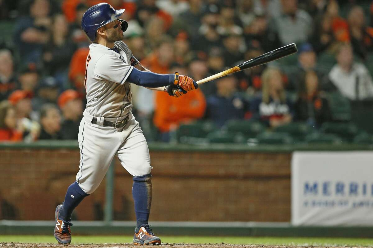 Houston Astros second baseman Jose Altuve (27) hits a grand slam home run against the San Francisco Giants in the sixth inning during an MLB game at Oracle Park, Friday, July 30, 2021, in San Francisco, Calif.