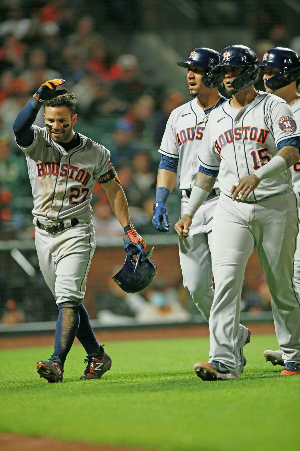 Houston Astros second baseman Jose Altuve (27) walks to the dugout with his teammates after Altuve hit a grand slam home run in the sixth inning during an MLB game against the San Francisco Giants at Oracle Park, Friday, July 30, 2021, in San Francisco, Calif.