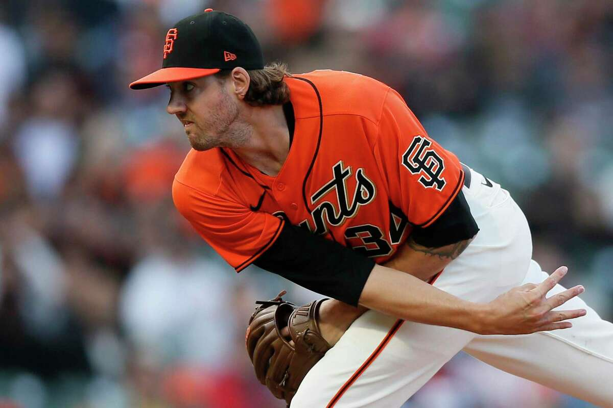 San Francisco Giants starting pitcher Kevin Gausman (34) in the first inning during an MLB game against the Houston Astros at Oracle Park, Friday, July 30, 2021, in San Francisco, Calif.
