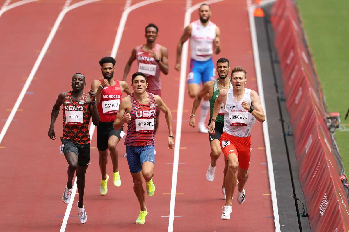 TOKYO, JAPAN - JULY 31: Emmanuel Kipkurui Korir of Team Kenya, Bryce Hoppel of Team United States and Mateusz Borkowski of Team Poland compete in round one of the Men's 800m heats on day eight of the Tokyo 2020 Olympic Games at Olympic Stadium on July 31, 2021 in Tokyo, Japan. (Photo by Christian Petersen/Getty Images)