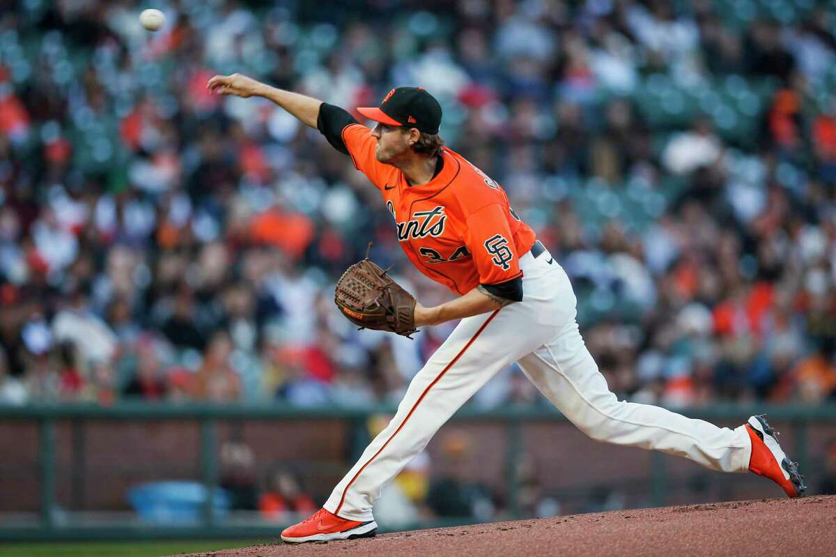 San Francisco Giants starting pitcher Kevin Gausman (34) in the first inning against the Houston Astros at Oracle Park, Friday, July 30, 2021, in San Francisco.