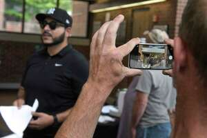 """SeanPaul Reyes led a protest, originally billed as a """"press conference"""" in front of and in the main lobby of the City Hall where he and his supporters streamed live video from their phones. Monday, July 19, 2021, in Danbury, Conn."""