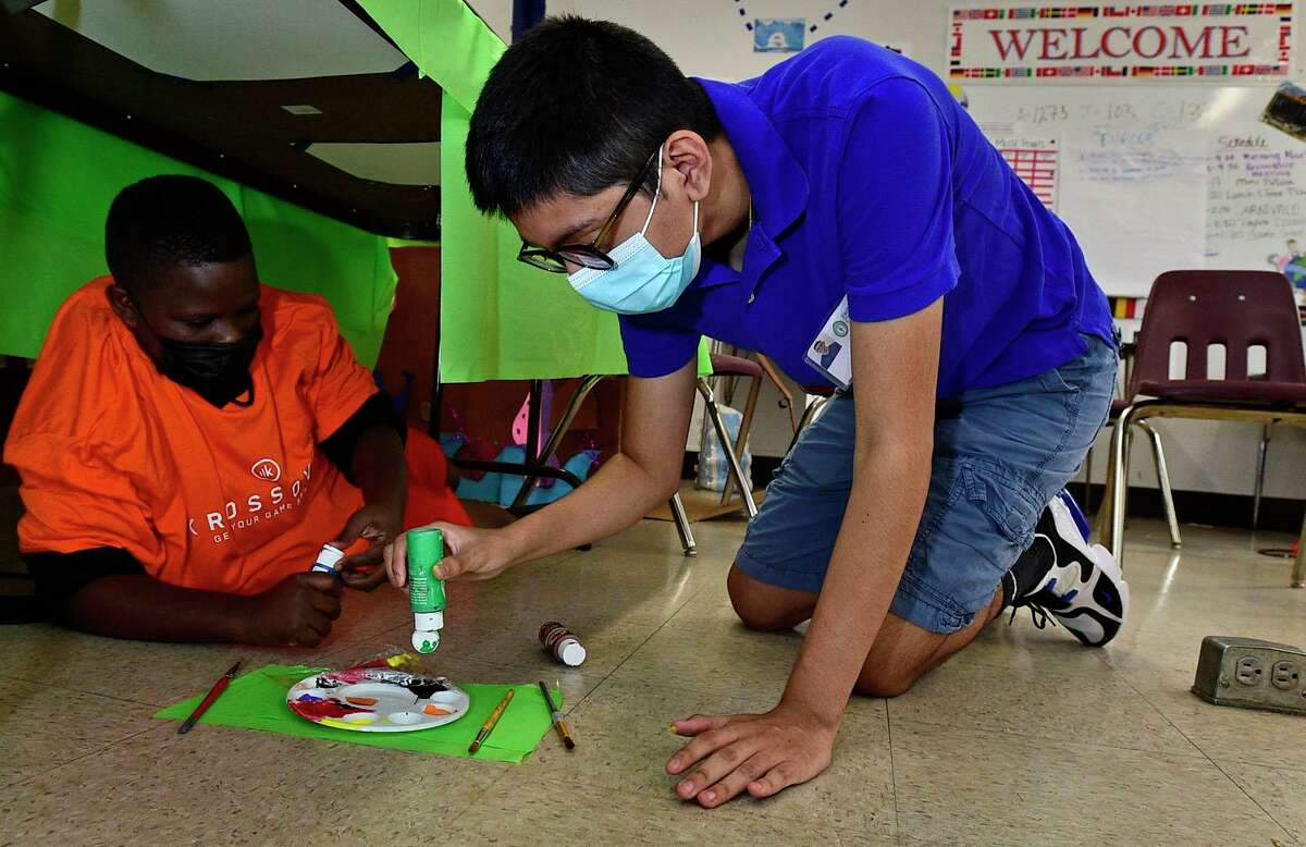 Intern Nate Lopez, 15, right, helps Garryn Constant during the ASPIRE summer program at the Familty and Children's Agency facility at Franklin School Tuesday, July 20, 2021, in Norwalk, Conn.