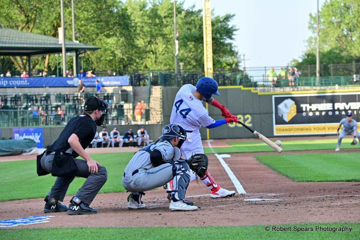Andy Pages hits a home run in the third inning of the Loons' 5-4 win over West Michigan on Friday at Dow Diamond. (Photo provided by Robert Spears)