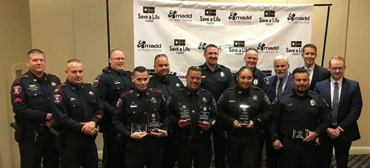 Members of Montgomery County law enforcement pose with awards at a Mothers Against Drunk Driving event July 21 in Houston.