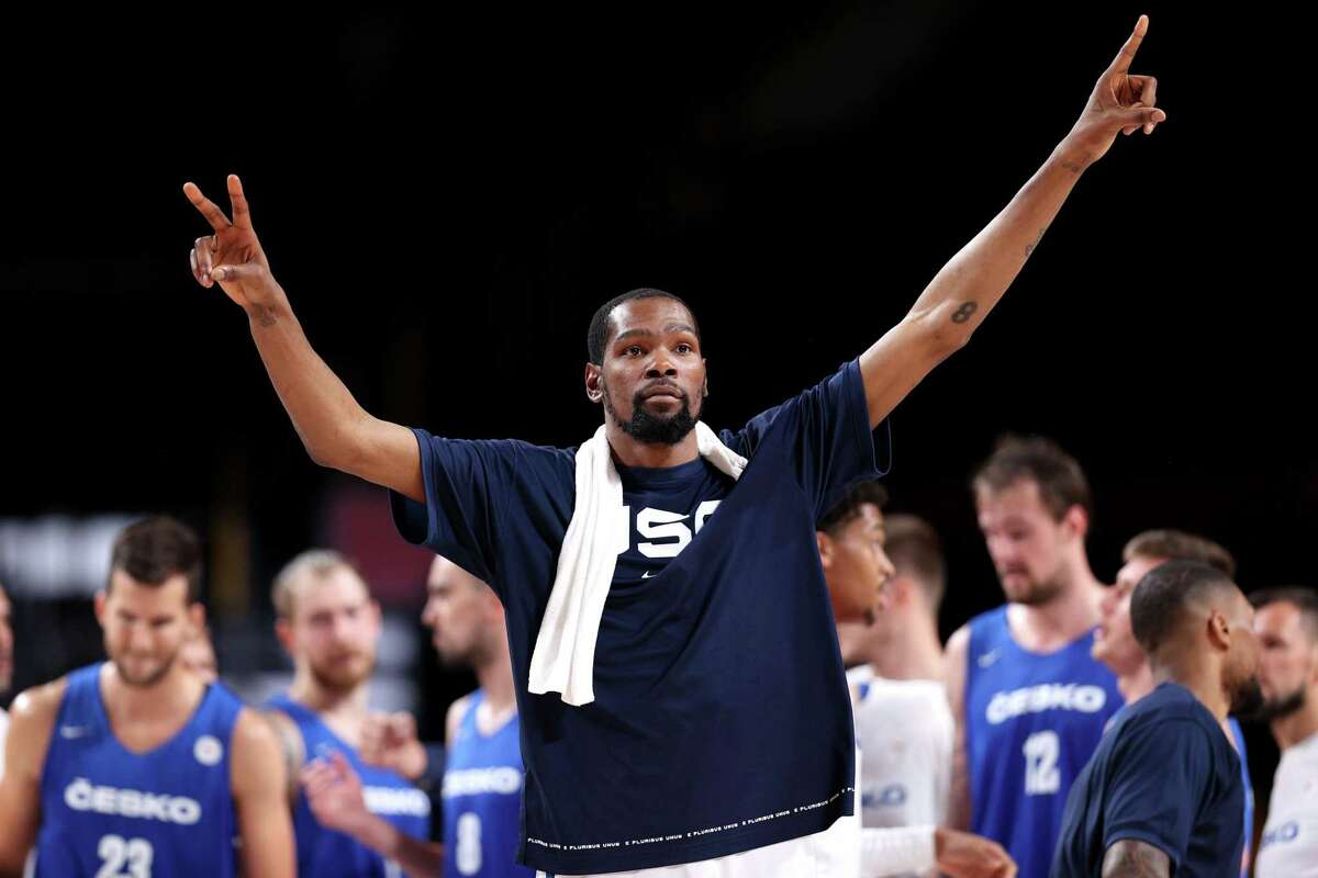 SAITAMA, JAPAN - JULY 31: Kevin Durant #7 of Team United States celebrates after defeating Team Czech Republic in a Men's Basketball Preliminary Round Group A game on day eight of the Tokyo 2020 Olympic Games at Saitama Super Arena on July 31, 2021 in Saitama, Japan. (Photo by Ezra Shaw/Getty Images)