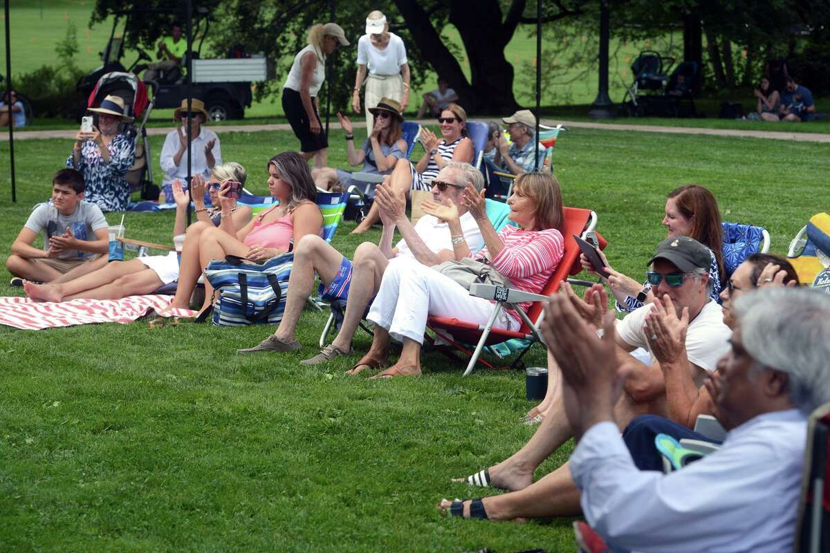 People gather at Greenwich Common for the weekly Free Music Fridays concert in Greenwich, Conn. July 30, 2021.
