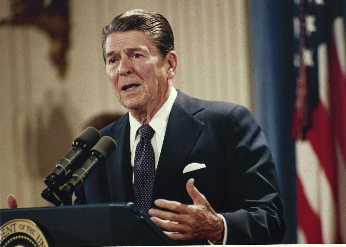 In this Oct. 19, 1983 photo, President Ronald Reagan speaks during a news conference at the White House in Washington.