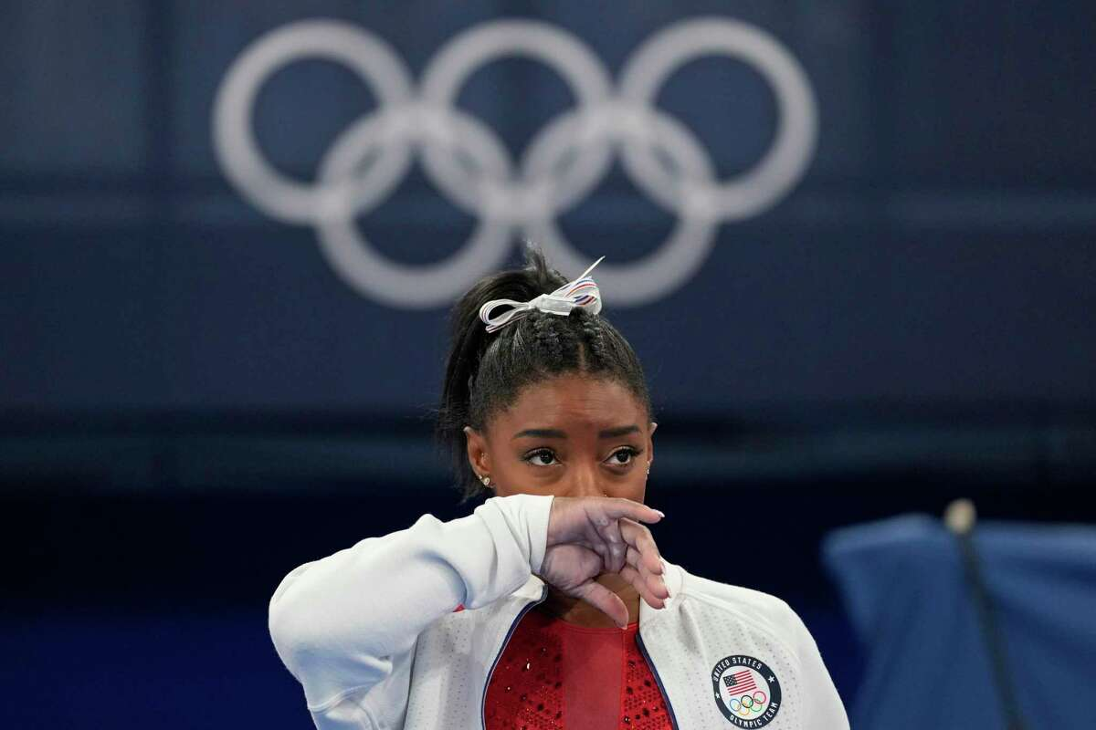Simone Biles watches gymnasts perform at the 2020 Summer Olympics on Tuesday in Tokyo. Biles withdrew from the team finals.