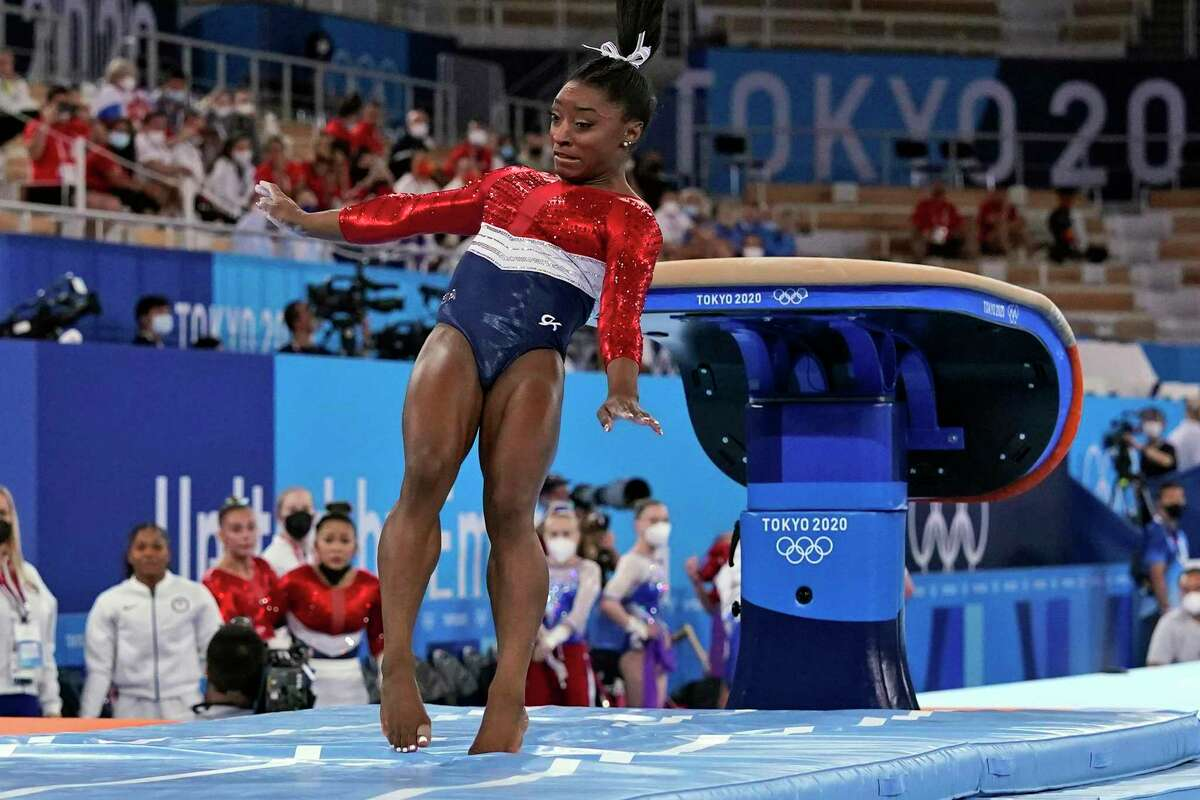 Simone Biles lands from the vault during the artistic gymnastics women's final at the 2020 Summer Olympics on Tuesday in Tokyo.