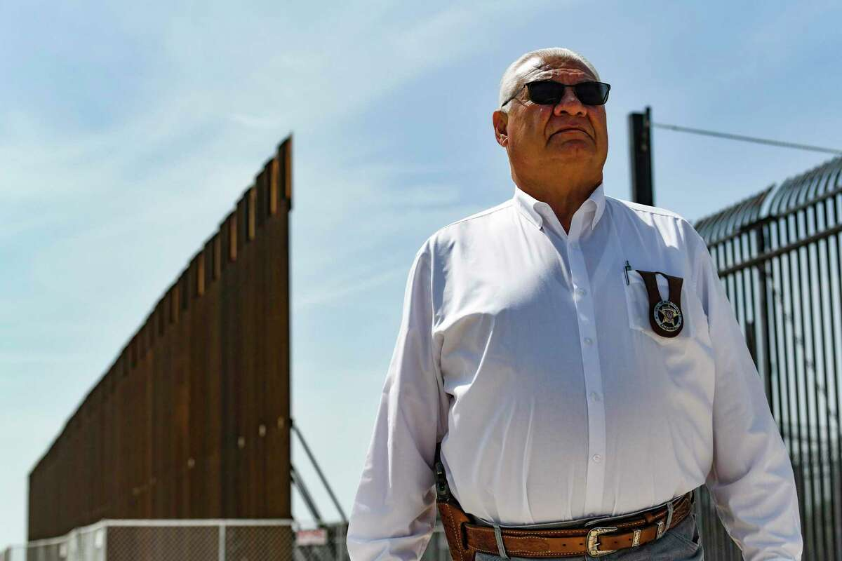 """Val Verde County Sheriff Joe Frank Martinez stops at disjointed sections of border barriers built by previous administrations. The large fence on the left is the so called """"Trump Wall."""" Gov. Greg Abbott has escalated the role of the Texas National Guard and Department of Public Safety troopers in an effort to stop the migration."""