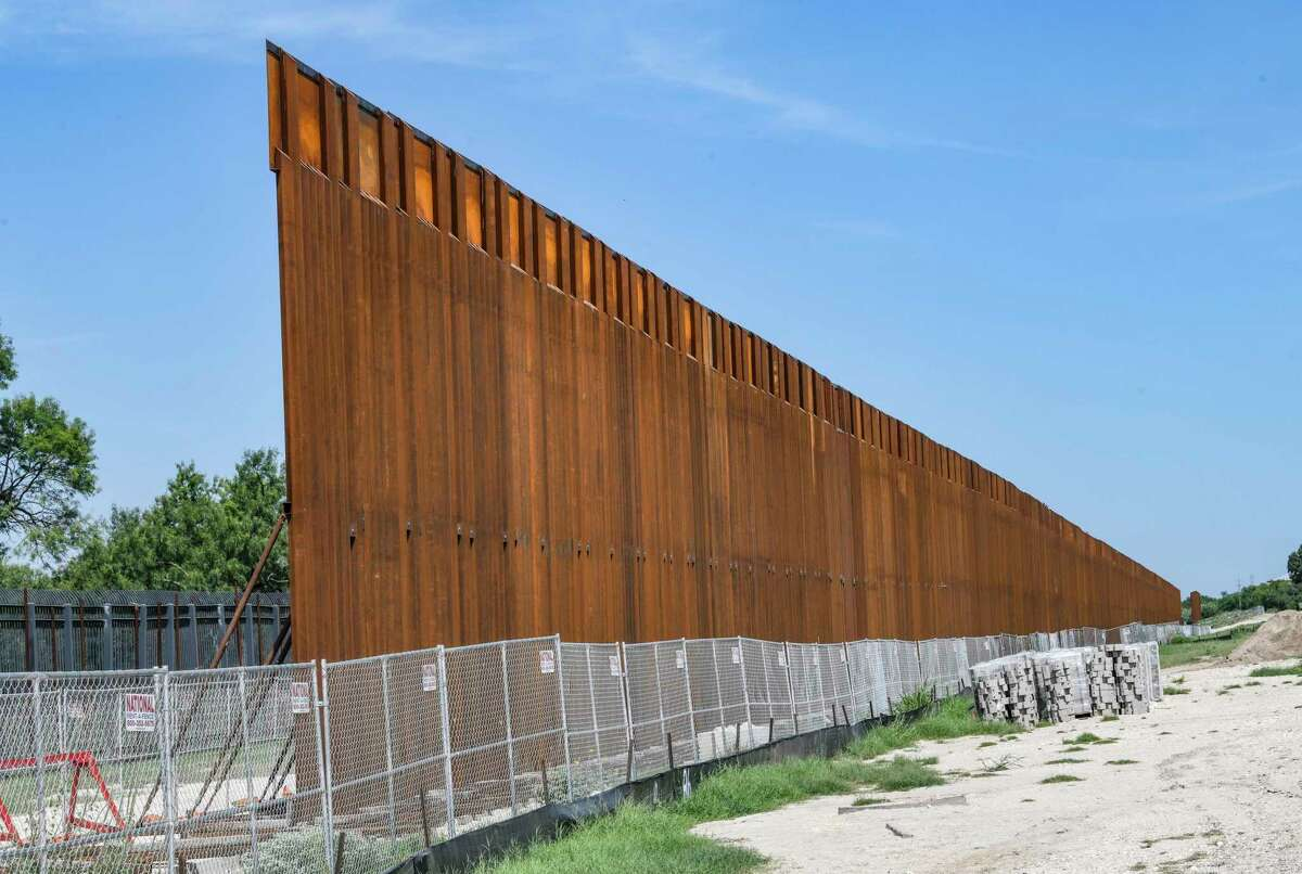 """The so called """"Trump Wall"""" near Del Rio ends near a chain link fence now being built by the Texas National Guard. An earlier fence put up by the Bush administration can be seen at left. Gov. Greg Abbott has escalated the role of the guard and Department of Public Safety in an effort to stop illegal crossings."""
