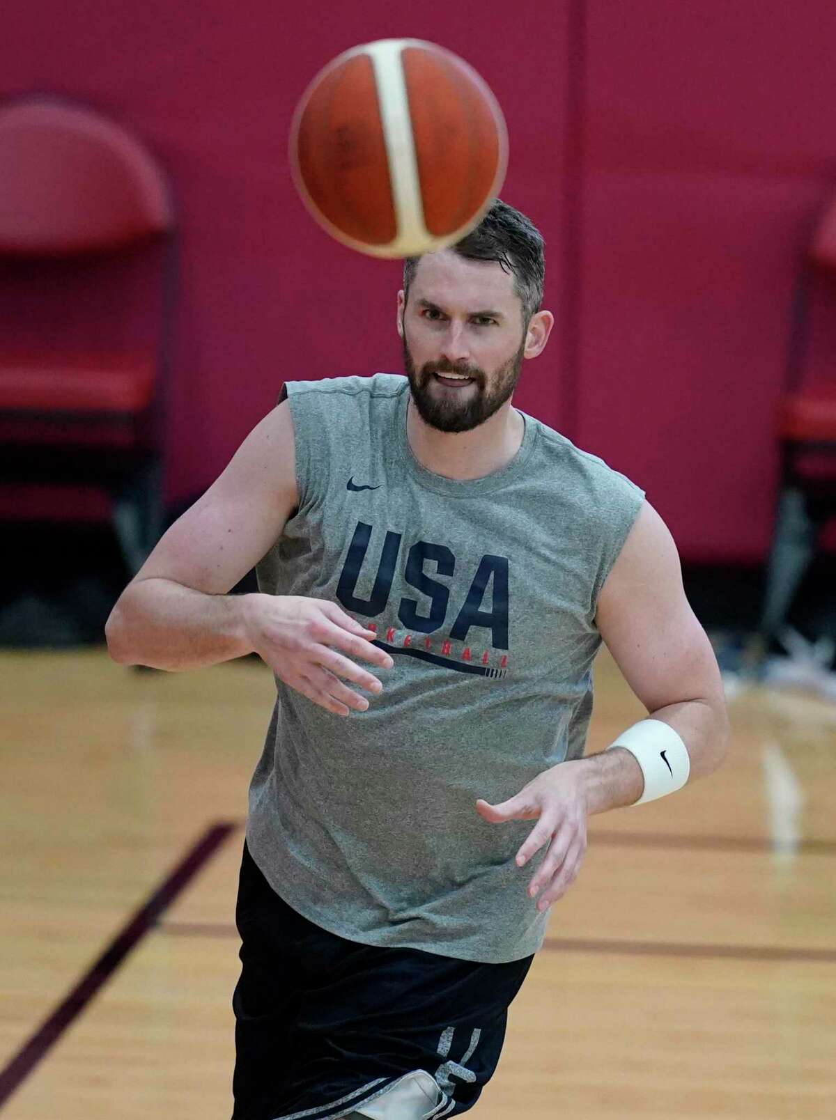 Kevin Love passes during practice for USA Basketball, Wednesday, July 7, 2021, in Las Vegas. (AP Photo/John Locher)