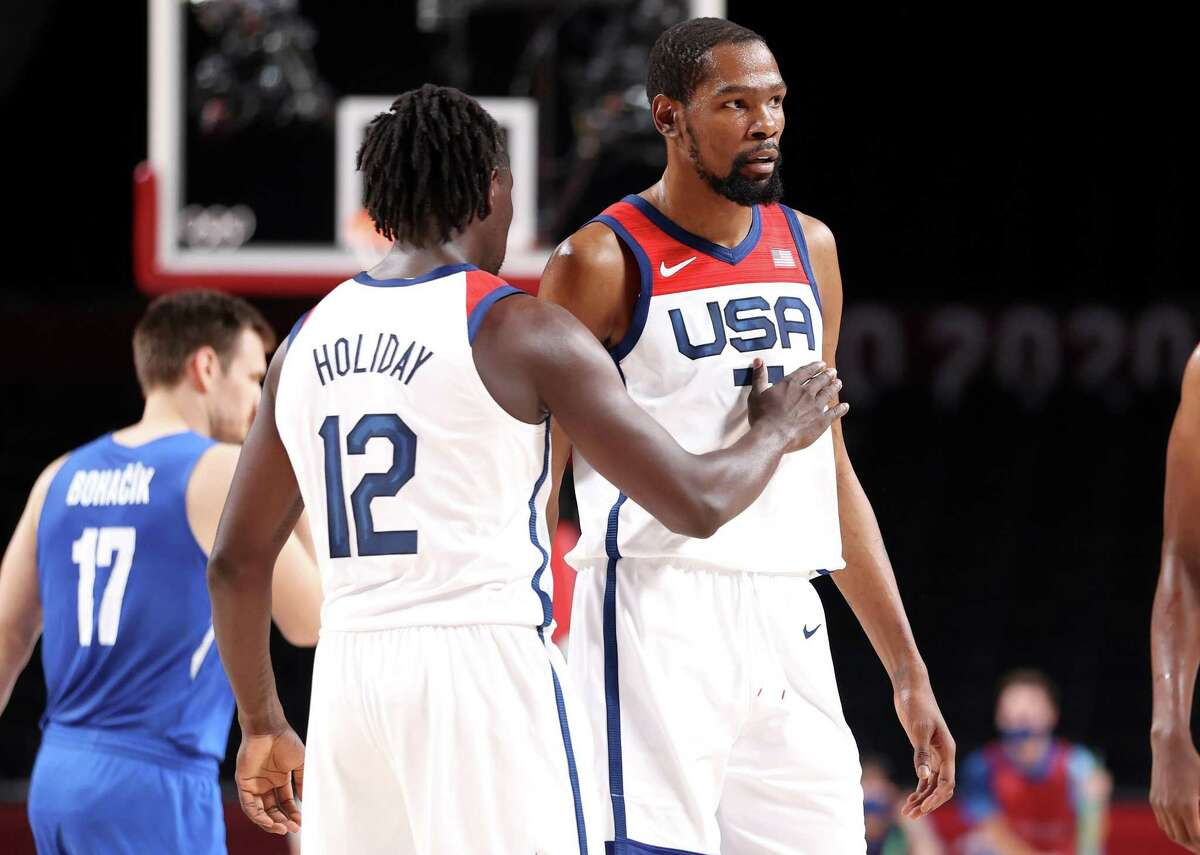 Jrue Holiday pats teammate Kevin Durant of Team United States on the chest during the first half of their Men's Basketball Preliminary Round Group A game against Czech Republic on day eight of the Tokyo 2020 Olympic Games at Saitama Super Arena on July 31, 2021 in Saitama, Japan.